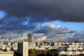 Dark clouds over the city — Stock Photo