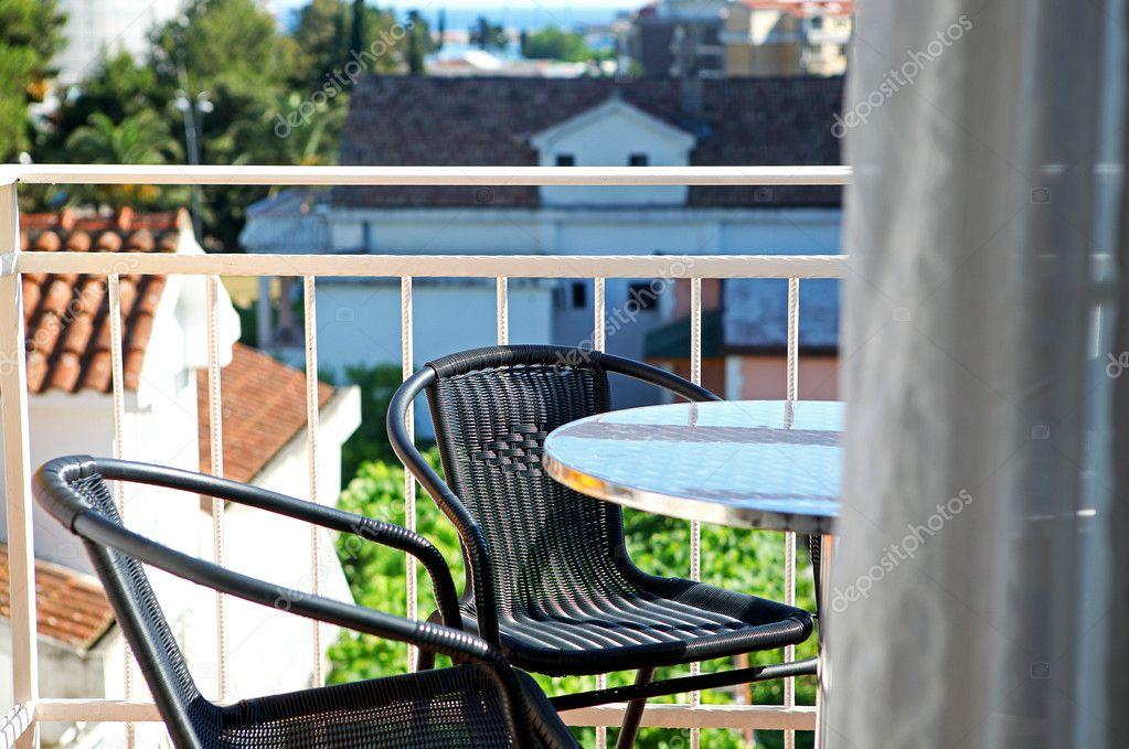 Стулья на балконе - стоковое фото geliumphoto #7388253.