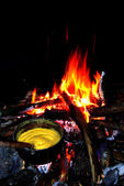 Hominy - traditional food at camp fire — Zdjęcie stockowe