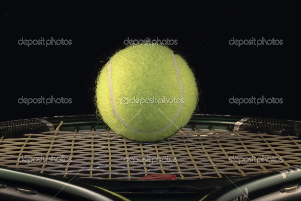 Ball and tennis racket on black background — Stock Photo #7278744