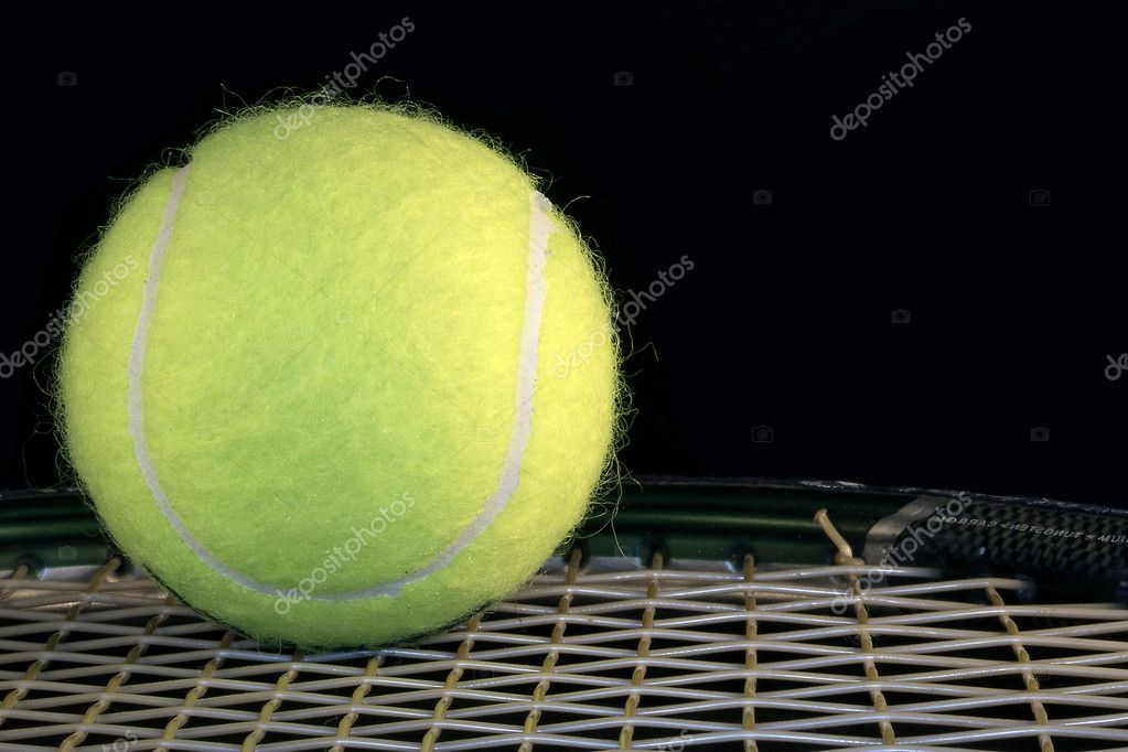 Ball and tennis racket on black background  Stock Photo #7518019