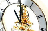 Gold table clock on a white background — Stock Photo