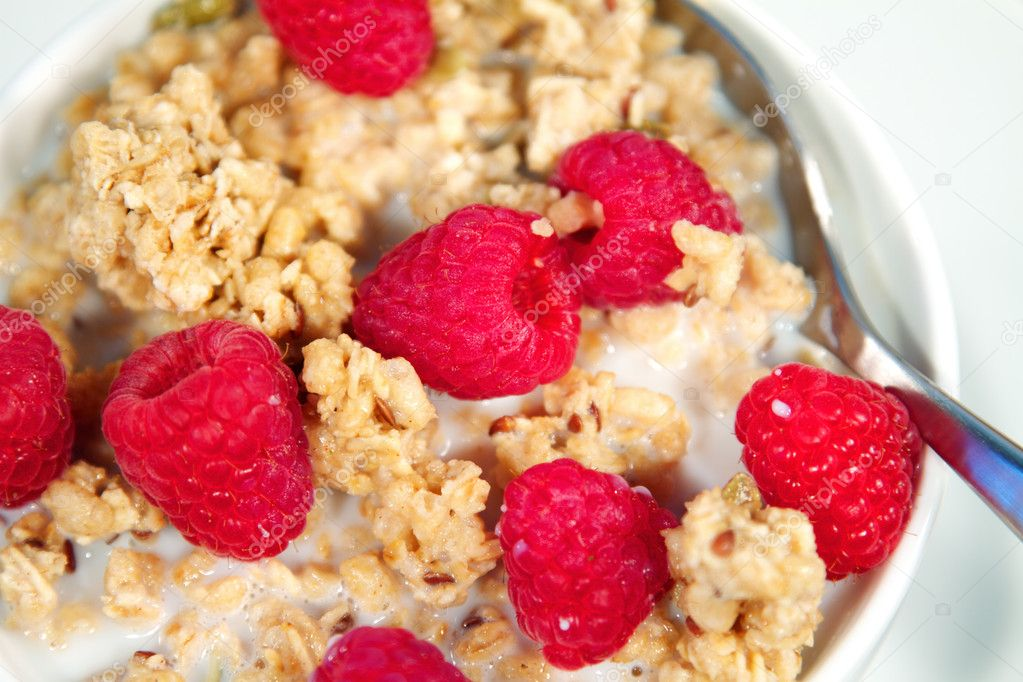 Fresh morning bowl of granola and raspberries with milk — Stock Photo #7339517