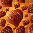 Seamless chocolate hearts background — Stock Photo