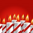 Stock Photo: Burning candle and shadow on red background