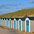 A row of cabins on the beach — Stock Photo