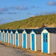 A row of cabins on the beach — Stock Photo #7313844