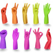 Colorful gloves signs isolated on white - Stock Photo