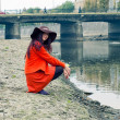 Girl on riverbank — Stock Photo #7608057