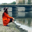 Girl on the riverbank — Stok fotoğraf