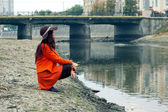 Girl on the riverbank — Stock Photo