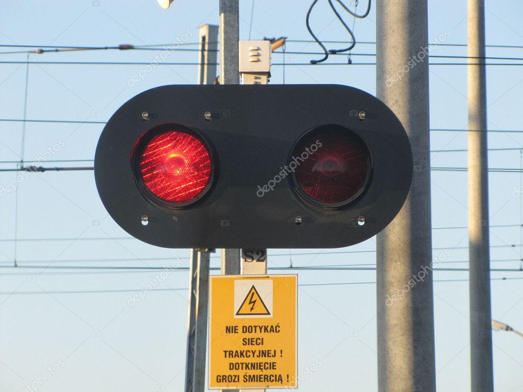 Signage - red light on rail crossing — Stock Photo #7316584