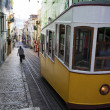 Yellow tram in the center of Lisbon, Portugal - Stock Photo