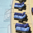 Stock Photo: Chairs By Swimming Pool