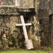 Royalty-Free Stock Photo: Lonely Cross Against Wall
