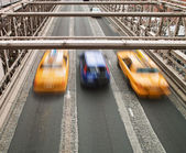 Taxis on Brooklyn Bridge — Stock Photo