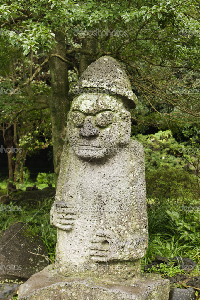 The statue of Mr. Hamadan is a common symbol of fertility on Jeju Island in Korea. Couples will touch his nose for good luck. — Stock Photo #7375294