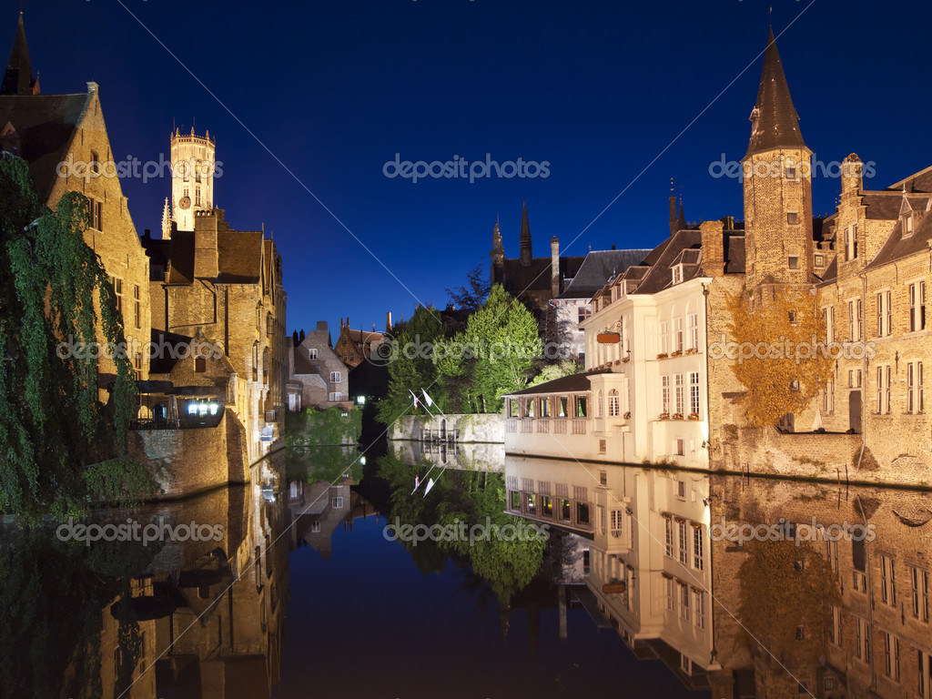 One of the main canals at night with nice reflections from the water. The landmark carillon, or belltower, at Market Square is visible in the upper left.  Stock Photo #7396778