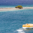 Stock Photo: Lifeboat Near Desert Island