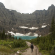 Hiker Approaching Iceberg Lake — Stock Photo