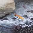Two Kayaks In Trouble - Stock Photo