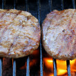Stock Photo: Two juicy burgers sizzling on grill