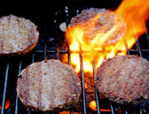 Sizzling Burgers On The Grill — Stock Photo