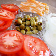Garnish Tray - Tomatoes, cheese, onions and olives — Stock Photo