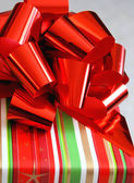 Christmas Gift With Big Red Bow — Stock Photo