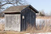Old Weathered Board and Batten Shed with Birdhouse — Stock Photo