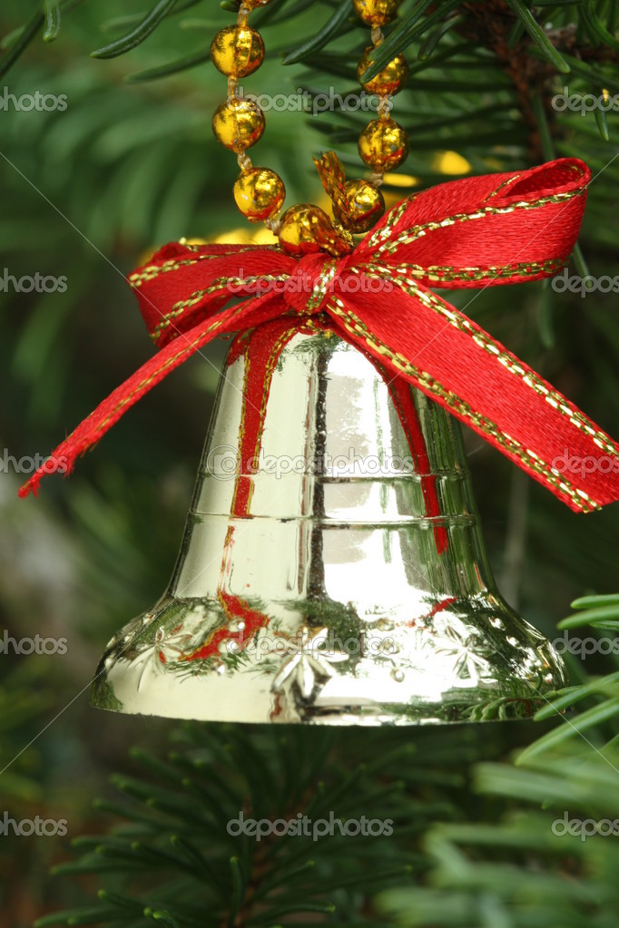 Red decorative bell on a Christmas tree.  Stock Photo #7447905