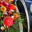 Flowers on car radiator — Stock Photo #7367399