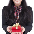 Businesswoman with a christmas gift box on her hand — Stock Photo