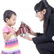 Working Mum gives a Present to her Daughter — Stock Photo