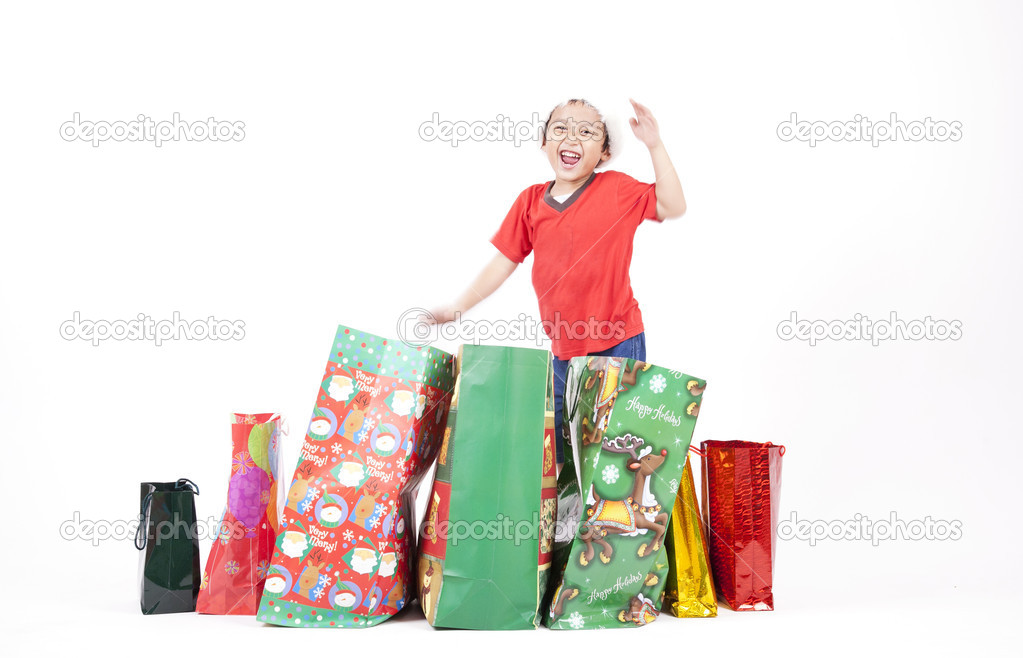 Excited boy with his Christmas gifts isolated on white — Stock Photo #7574223