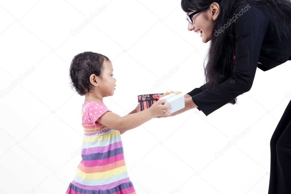 Working mum gives her daughter christmas presents  Stock Photo #7575355