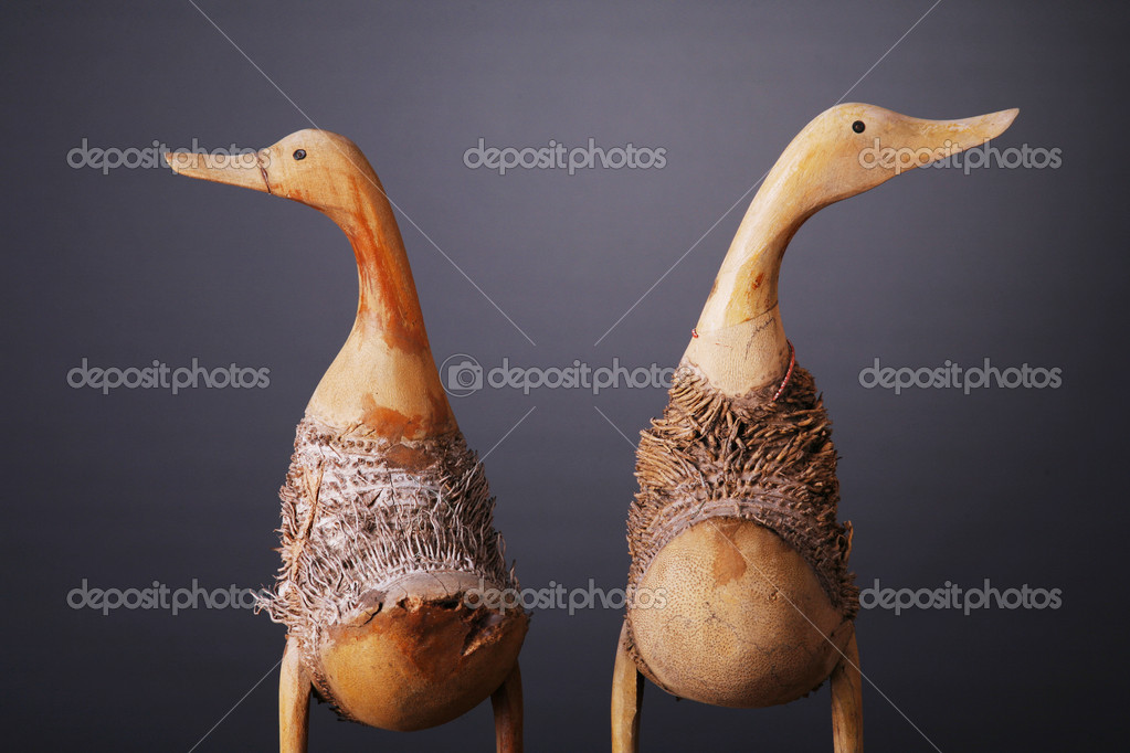 Wooden ducks shot over gray background — Stockfoto #7579429