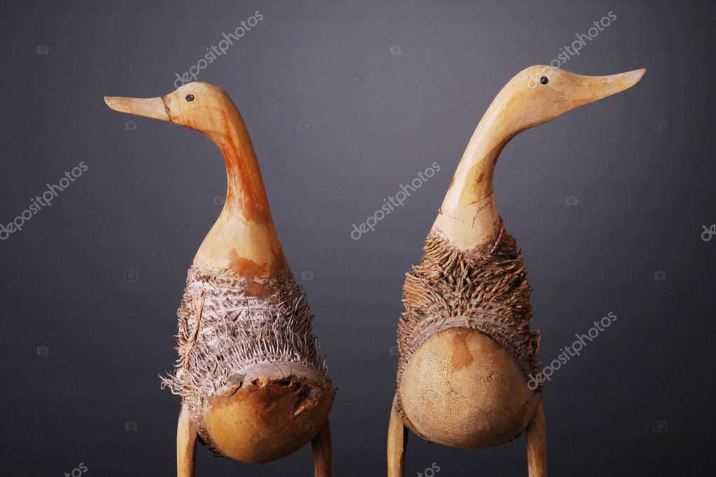 Wooden ducks shot over gray background — Stok fotoğraf #7579429