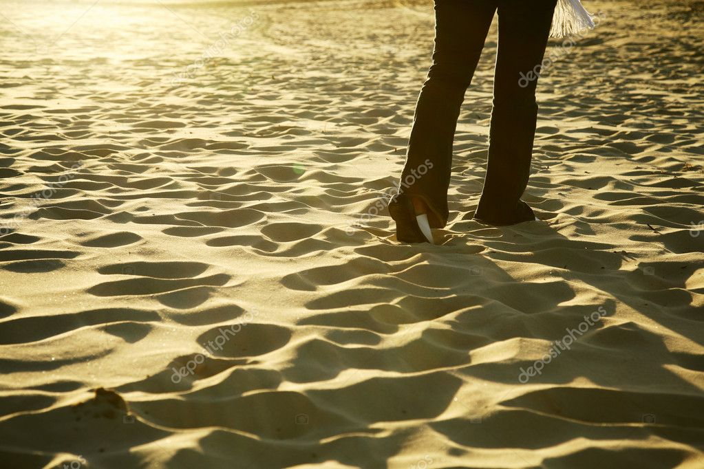 Walking on the sandy beach at sunset  Stock Photo #7587933