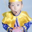 Schollar dressed toddler with piggybank — 图库照片