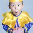 Schollar dressed toddler with piggybank — Stock fotografie