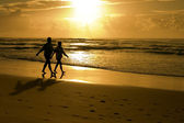 Silhouette of a Couple on beach — Stock Photo