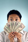 Shocked Woman with Money — Stock Photo
