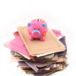 Piggy bank on top of stack of folders — Stock Photo