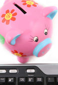 Piggybank and Keyboard — Stock Photo