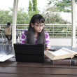 Attractive Asian Student working on her assignments — Stockfoto