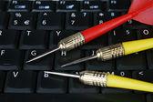 Darts on Laptop — Stock Photo