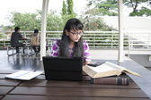 Attractive Asian Student working on her assignments — Stock Photo