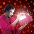 Beautiful Woman Open a present - Stock Photo