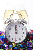 Alarm Clock with Champagne Glass — Stock Photo